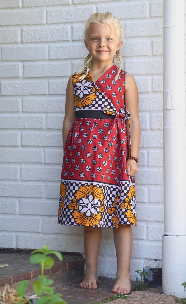Pyret showing a dress made by our sewing project